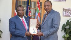 President Uhuru Congratulating COTU-K Secretary General Bro. Atwoli for his National Order of Merit Award given to him by Algeria President Abdelaziz Bouteflika
