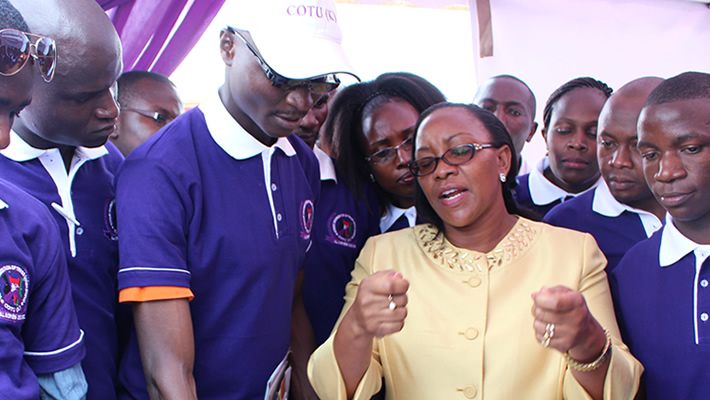 Cabinet secretary Public Service, Youth and Gender Affairs Sicily Kariuki with Youthful Trade Unionist at the COTU-K Exhibition Stand.